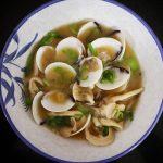 Clams miso soup with oyster mushrooms and scallions