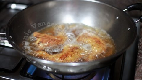 Frying chicken in a wok