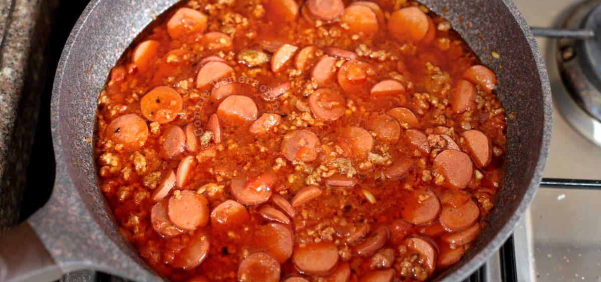 Filipino spaghetti meat sauce with sliced hotdogs