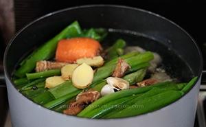 Shiitake stems added to pot of broth