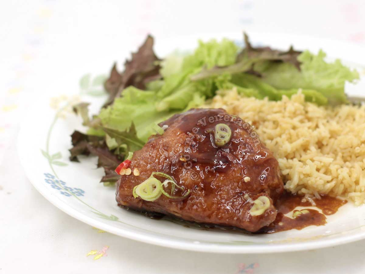 Paksiw lechon manok on plate with rice and vegetables