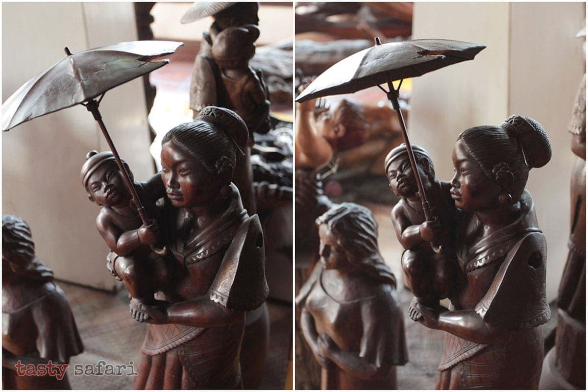 A sculpture of a mother holding an umbrella over her infant child at the Balaw-balaw Museum