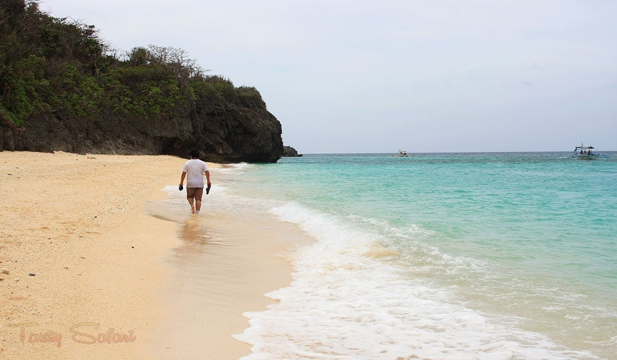 My husband, Speedy, walking in the shore of Puca Beach