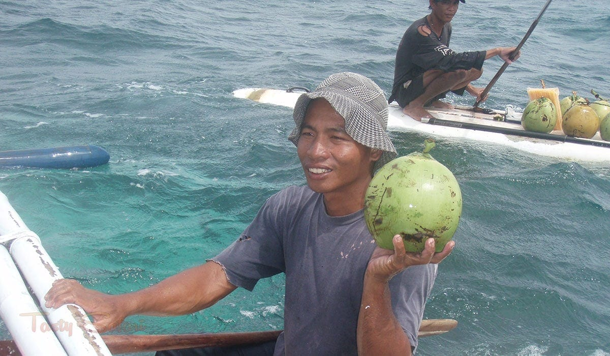 Coconut vendors in the middle of the sea in Boracay