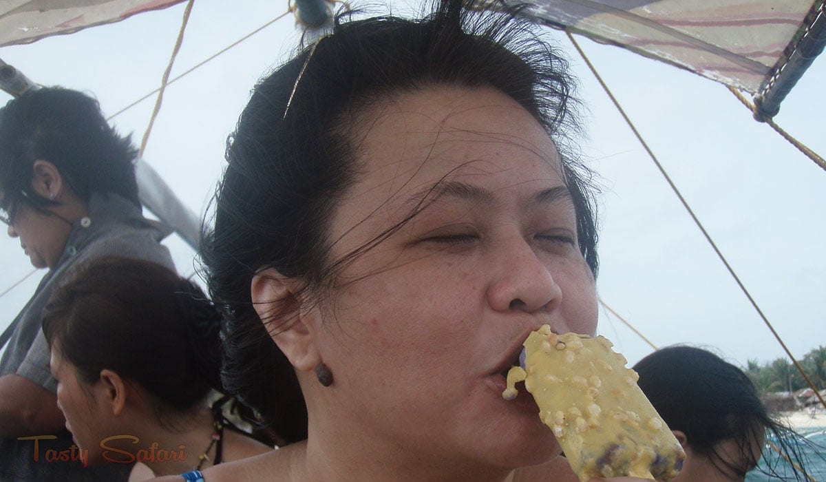 Enjoying pinipig crunch in the middle of the sea in Boracay