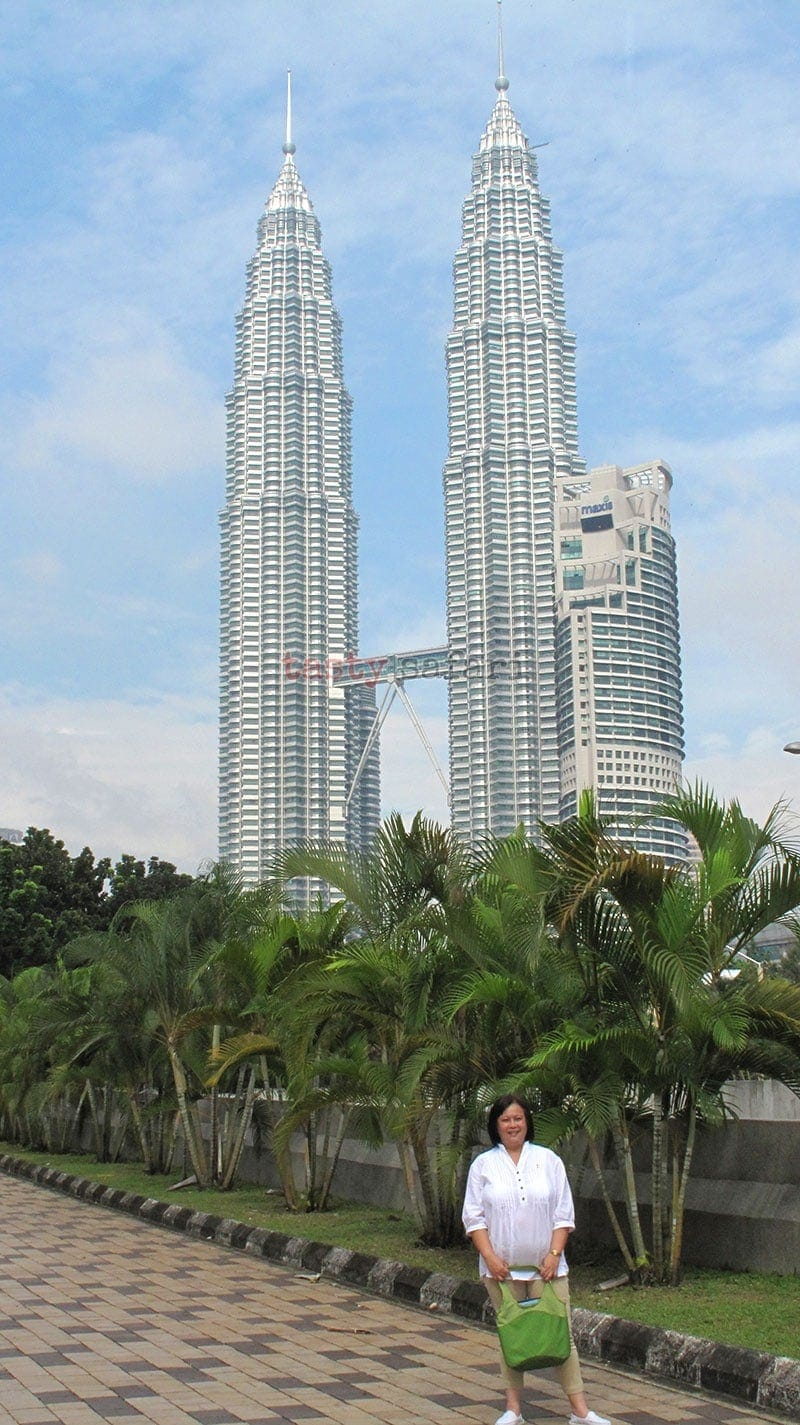 Being a tourist in Kuala Lumpur means having photos taken with the Petronas Towers as backdrop.