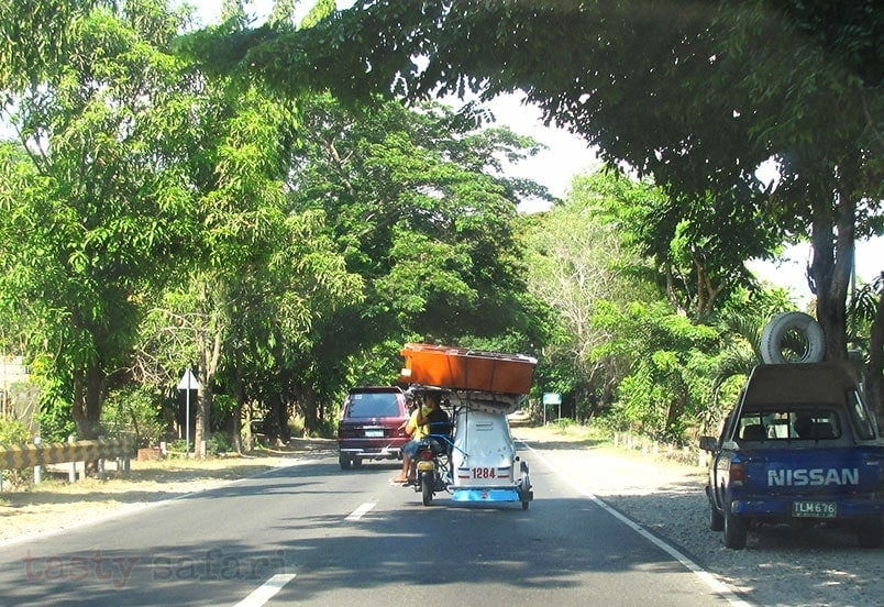An ubiquitous rural scene: a closet loaded on the roof of a tricycle