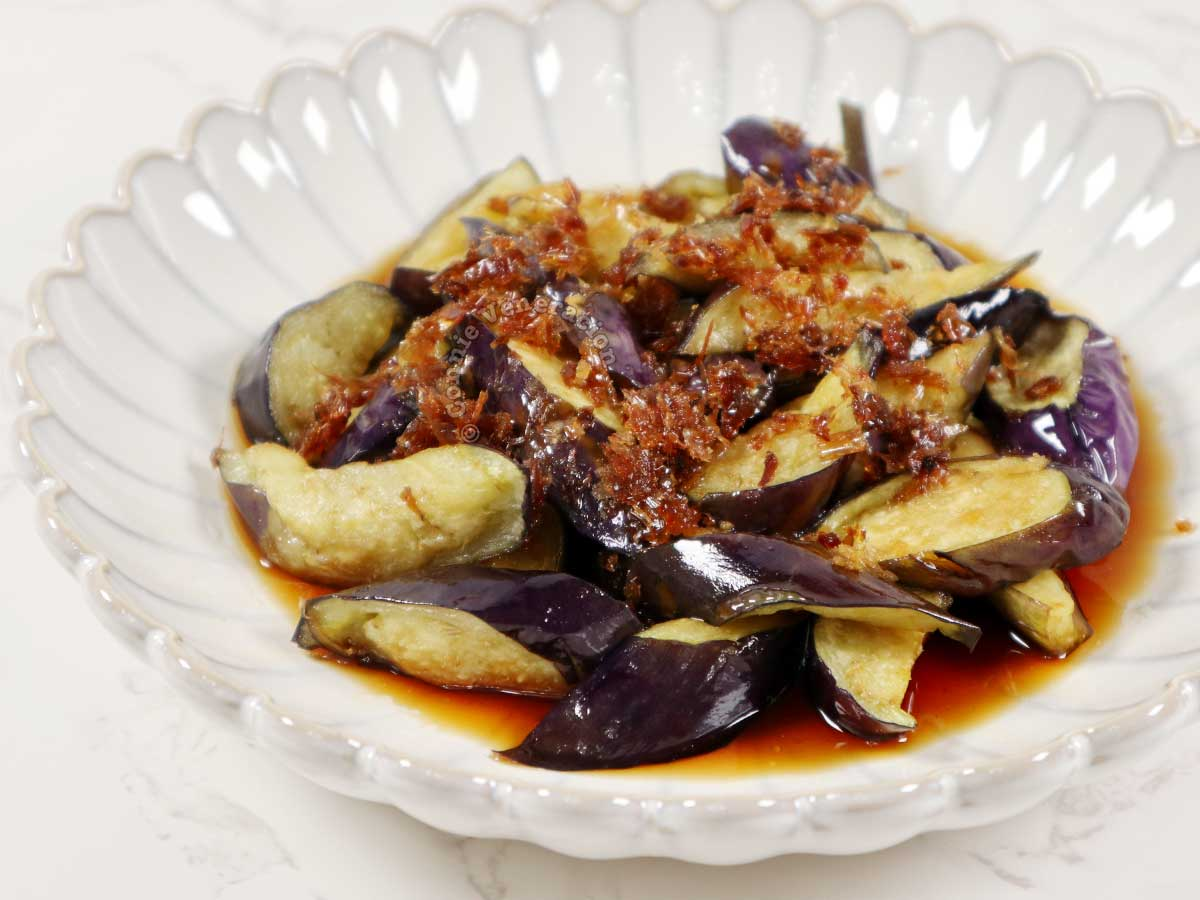 Fried eggplants doused with ginger dashi sauce and topped with crispy bonito flakes