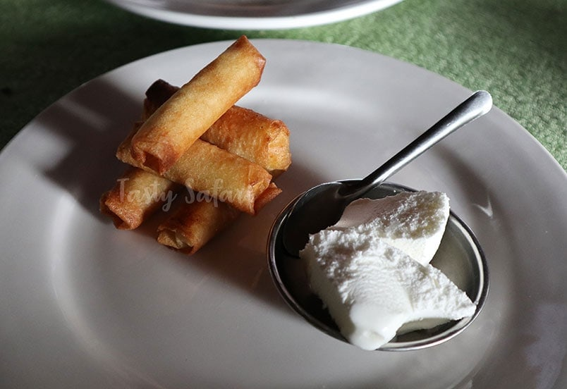 Banana spring rolls served with frozen coconut cream
