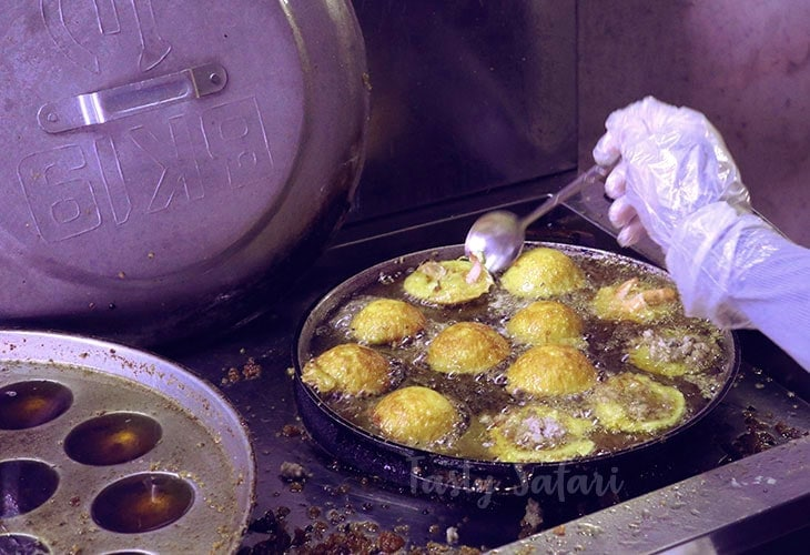In Saigon, bánh khọt cooking in a special frying pan