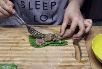 Beef and Mustard Greens Wrapped in Rice Paper, Step 1: Place mustard greens on rice paper and top with beef slices