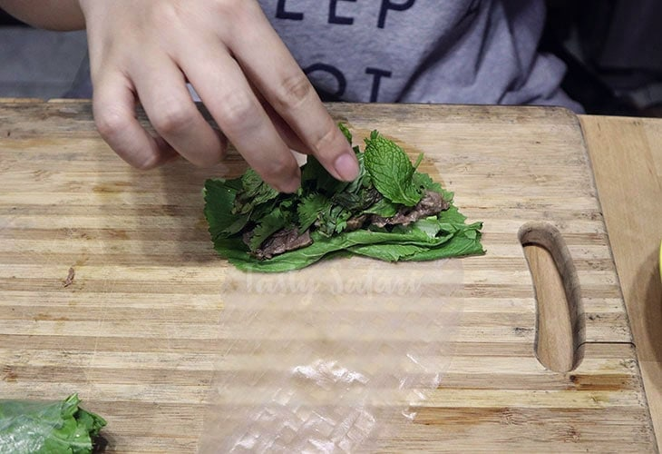 Beef and Mustard Greens Wrapped in Rice Paper, Step 2: Top beef with basil, mint and cilantro
