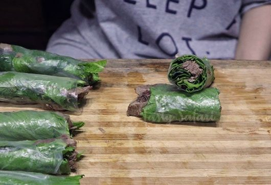Beef and Mustard Greens Wrapped in Rice Paper, Step 5: Cut the rolls in half to shop the layers of filling