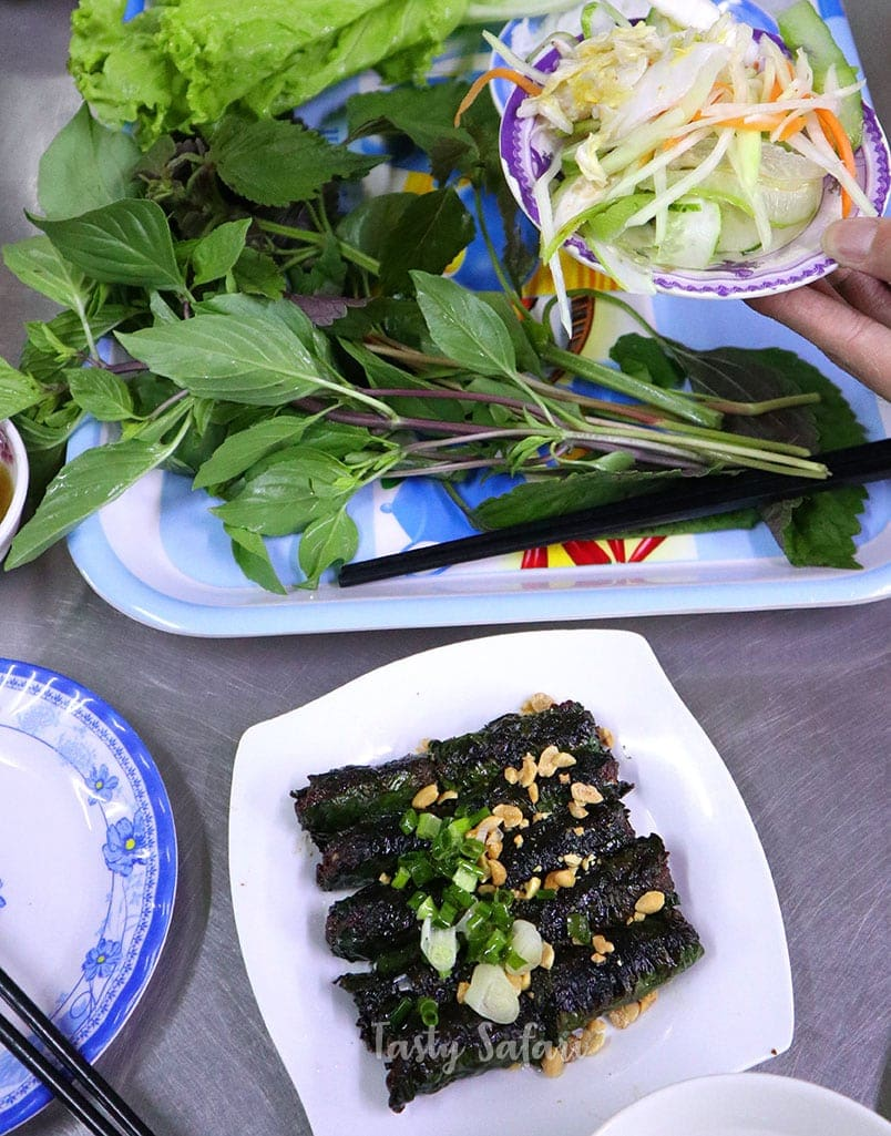 """Bo la lot, a Vietnamese street food made of beef wrapped in lolot leaves (referred to as """"betel"""" by English speakers)"""