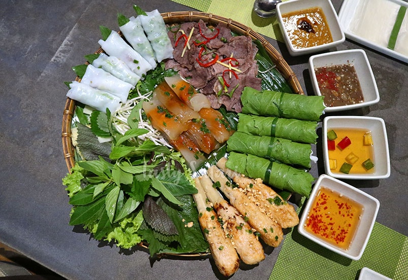 Spring rolls and beef brisket served with lettuce, mustard greens, herbs and dipping sauces.
