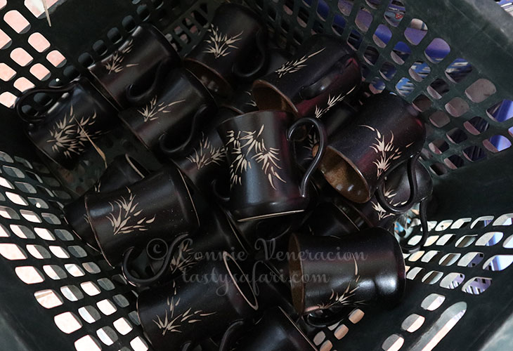 Tapered black coffee mugs with bamboo design. Bat Trang Village, Vietnam