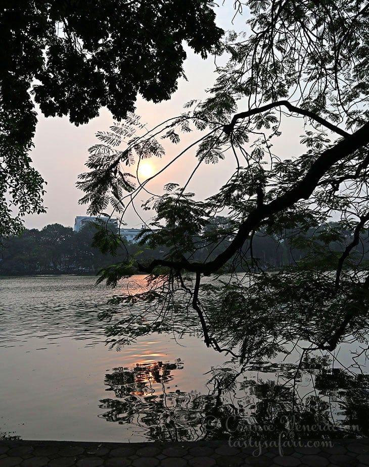 Late afternoon. Sunlight reflected on water. Hoan Kiem Lake, Hanoi.