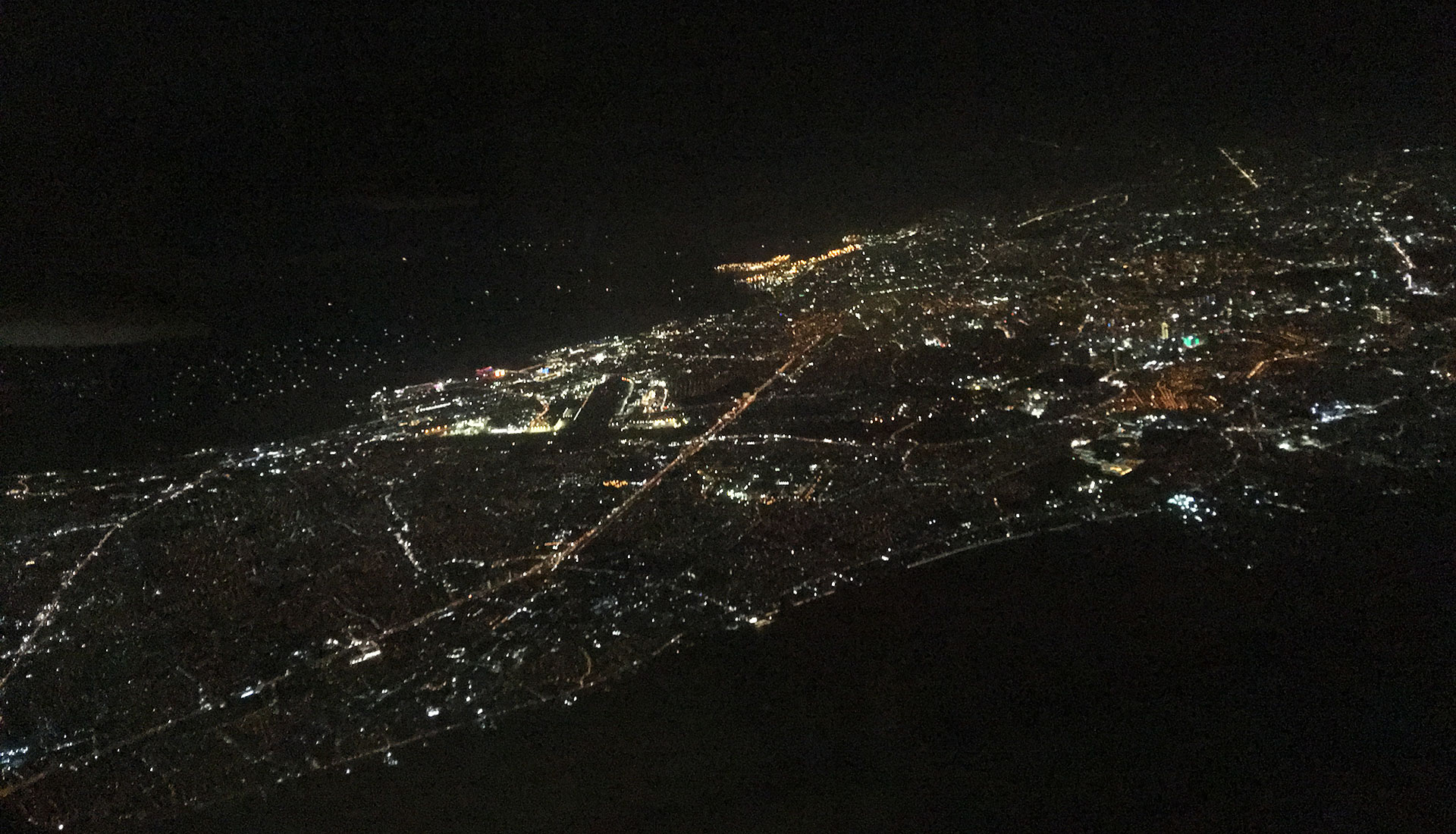 Aerial view of Manila and surroundings at night.