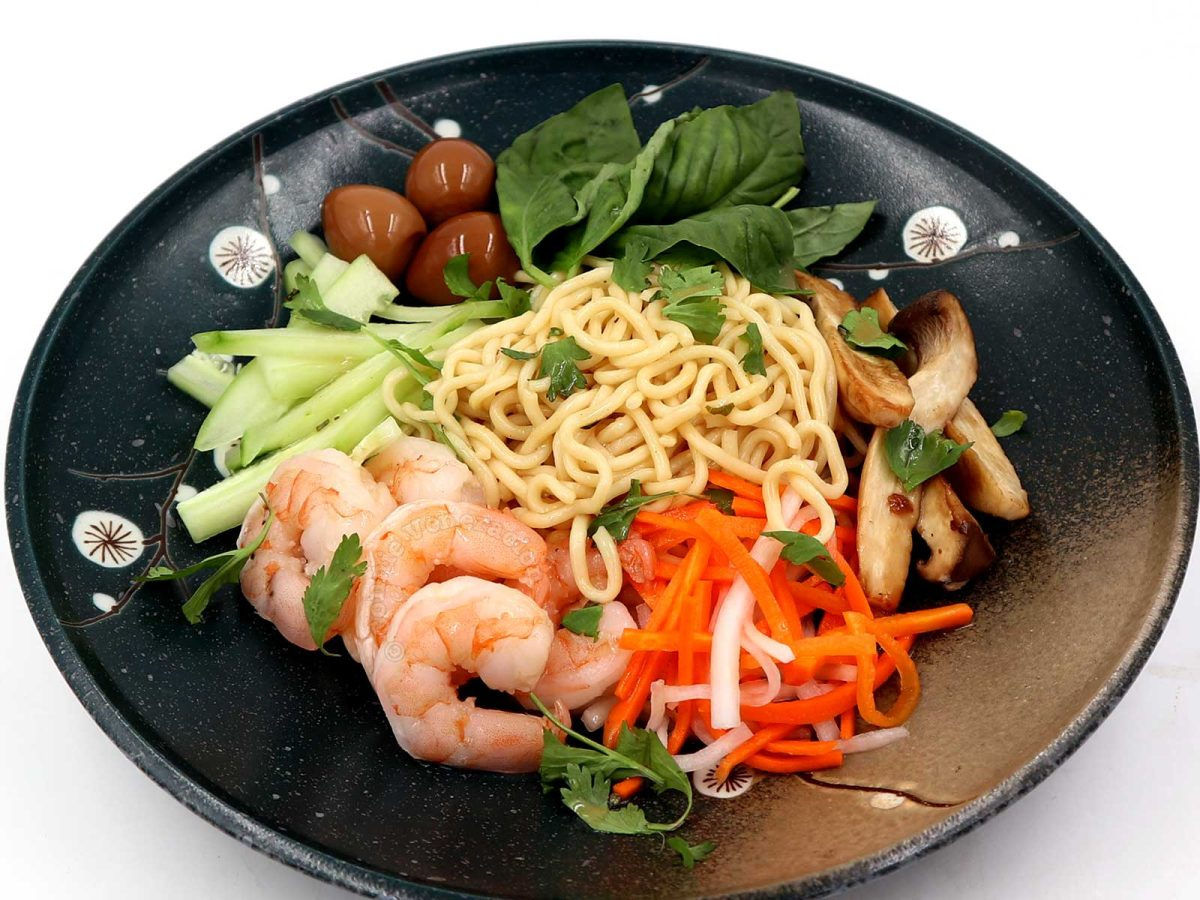 Asian cold noodle salad with mushrooms, pickled carrot and radish