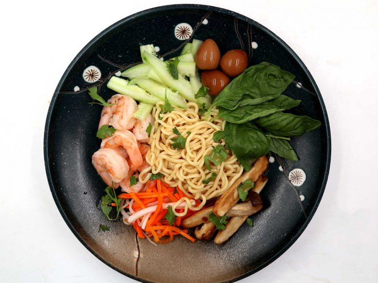 Asian cold noodle salad with shrimps and quail eggs