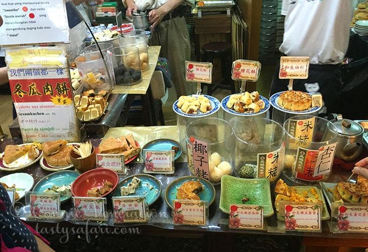 Sampling delicacies at Tamsui Old Street