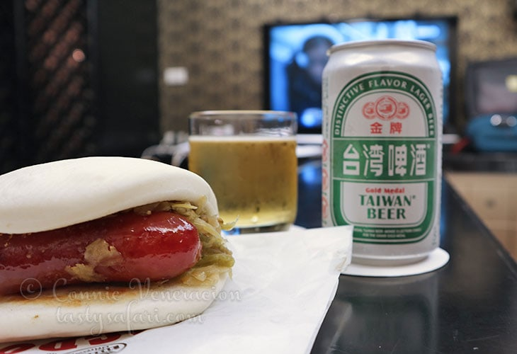 Taiwan Beer and sausage in bun