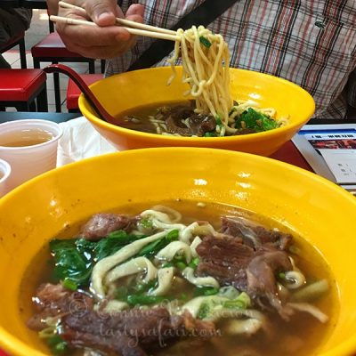 Taiwanese beef noodle soup at a food court in Taipei