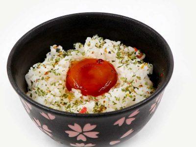 Shoyuzuke egg yolk served over rice sprinkled with furikake