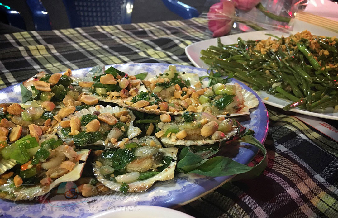 Stir fried scallops on half shells sprinkled with peanuts. Saigon, Vietnam