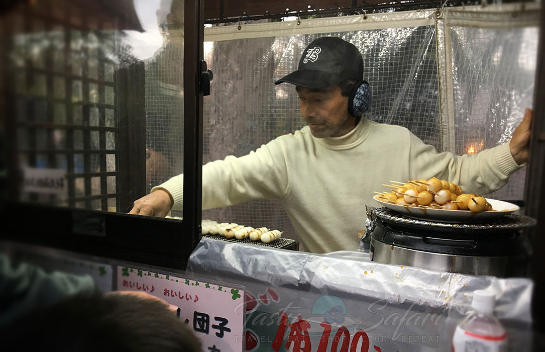 Dango, grilled skewered sticky rice balls, sold by a hawker in Nara, Japan