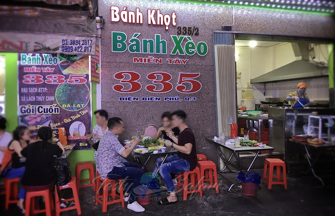 In Saigon's District 3, a brick-and-mortar street food seller specializing in banh khot and banh xeo