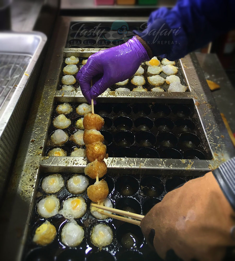Skewered fried quail eggs. Tamsui waterfront, Taiwan