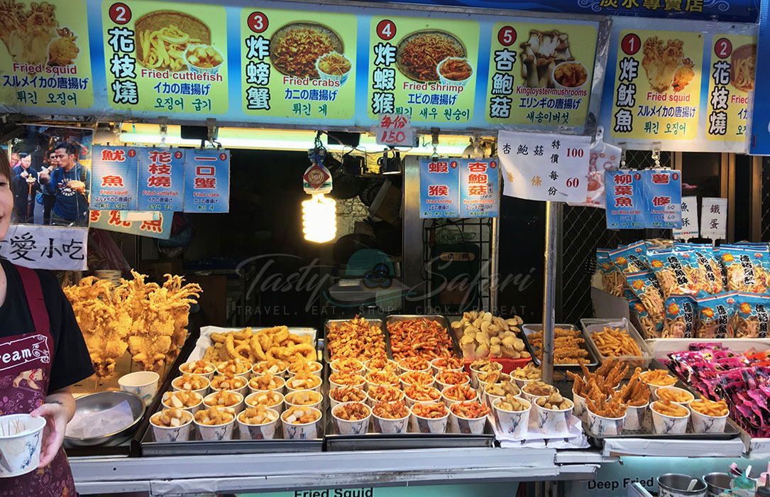 Various deep fried food served in disposable paper cups. Tamsui Old Street, New Taipei City, Taiwan