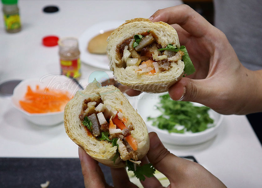 Cross cut of our hmemade banh mi with roast pork belly filling