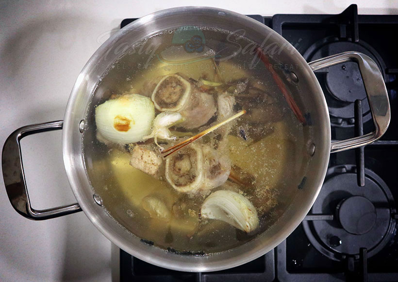 Simmering bones and spices for beef pho broth