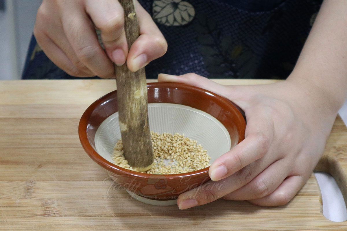 Grinding toasted sesame seeds in a suribachi, a Japanese mortar