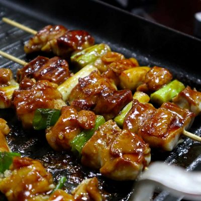 Grilling yakitori on a stovetop grill