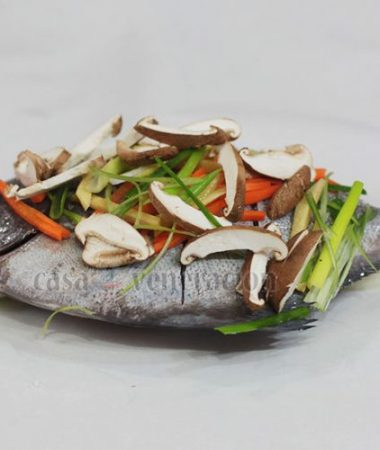 Whole fish with mushrooms and vegetables