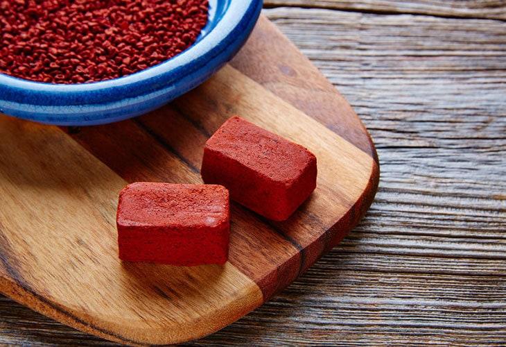 Blocks of annatto paste