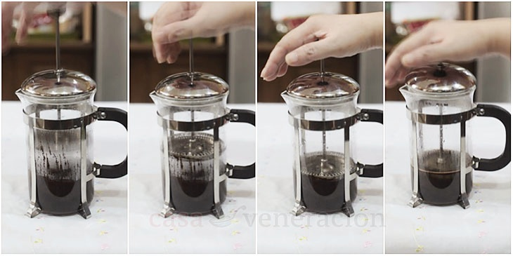 Pressing ground coffee with a French press