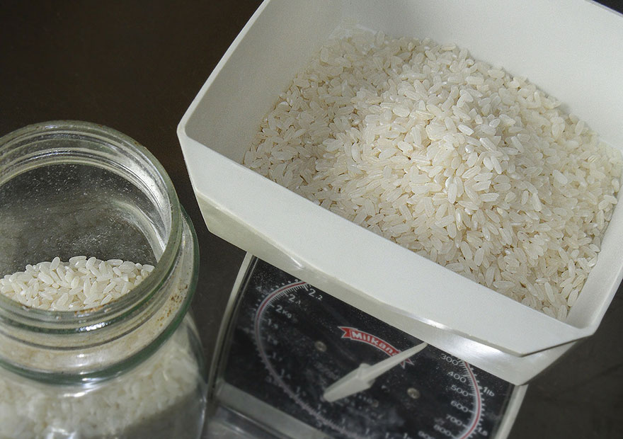 Measure the rice either by weighing or using a measuring cup
