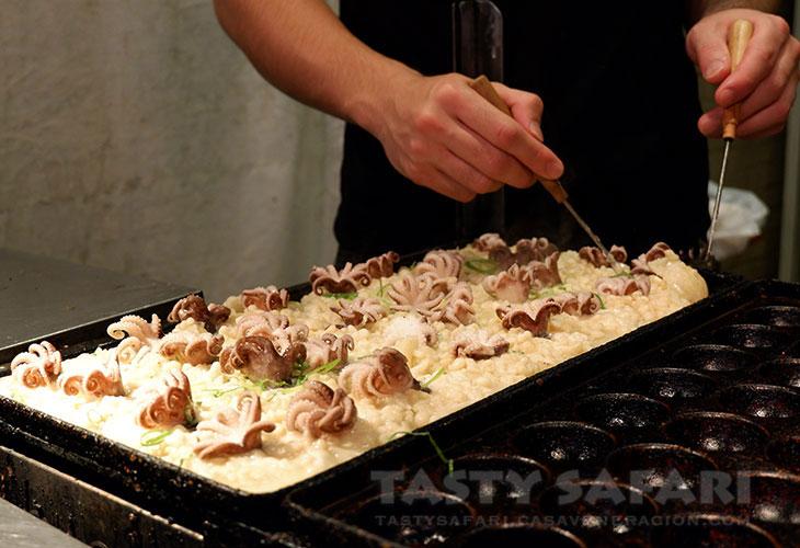 At Dotonbori, takoyaki with whole octopus