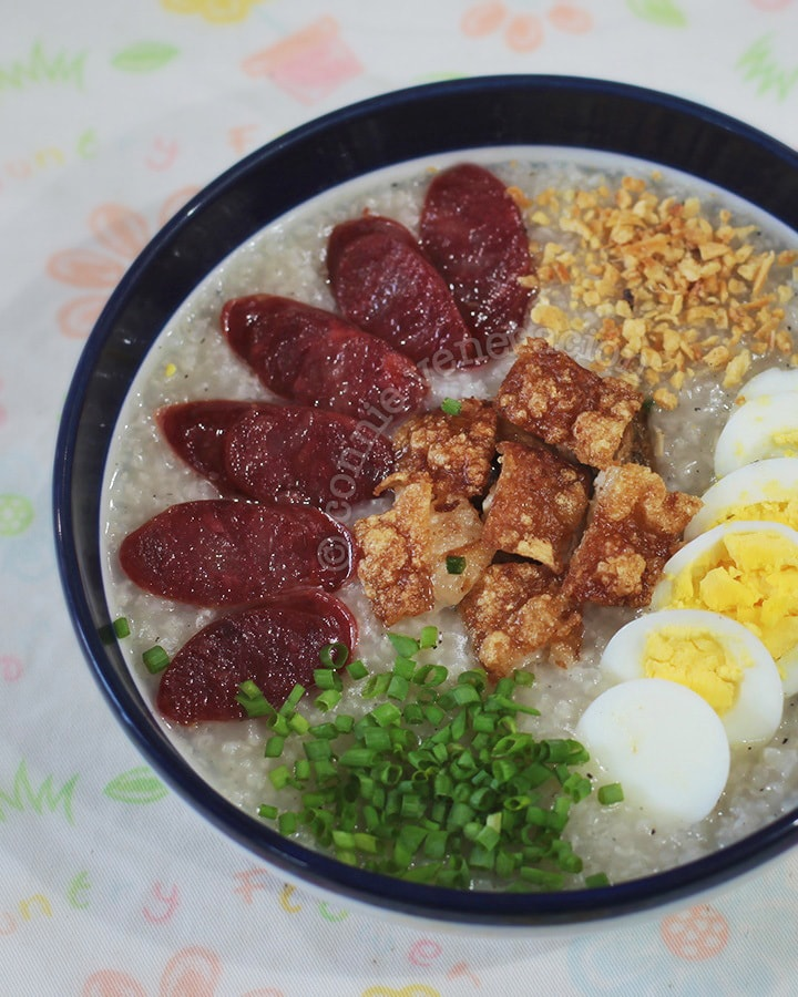 Slow cooker congee with roast pork belly, Chinese sausage, egg, scallions and toasted garlic