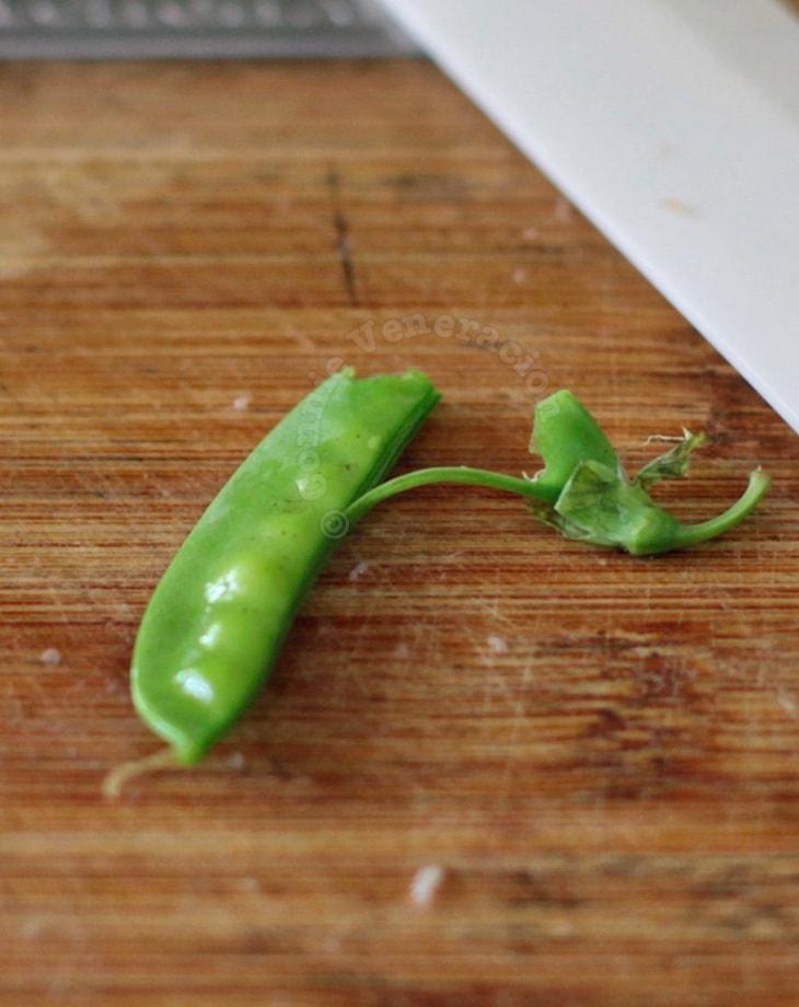 Stringing peas in pod