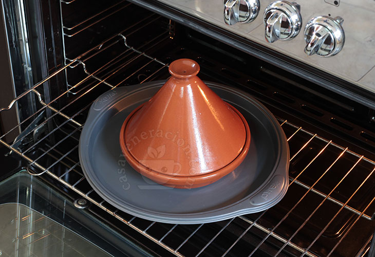 Heating oiled tagine (tajine) in the oven before first use