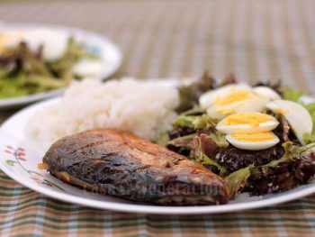 Tinapang bangus (smoked milkfish) egg, rice and vegetables in a plate