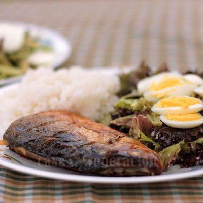 Tinapang bangus (smoked milkfish) egg, rice and vegetables in a plate