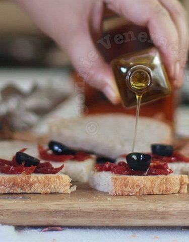 Drizzling truffle oil on bread