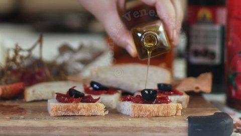 Drizzling truffle oil on bread