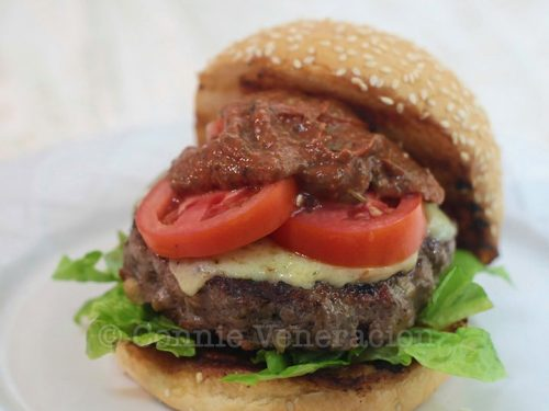 Burger with lettuce and tomatoes